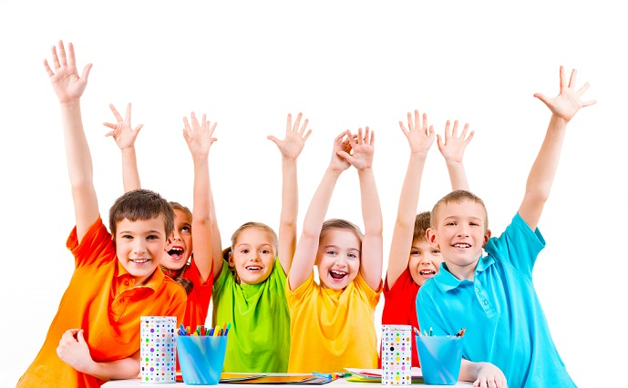 group-children-colored-t-shirts-sitting-table-with-raised-hands5.jpg